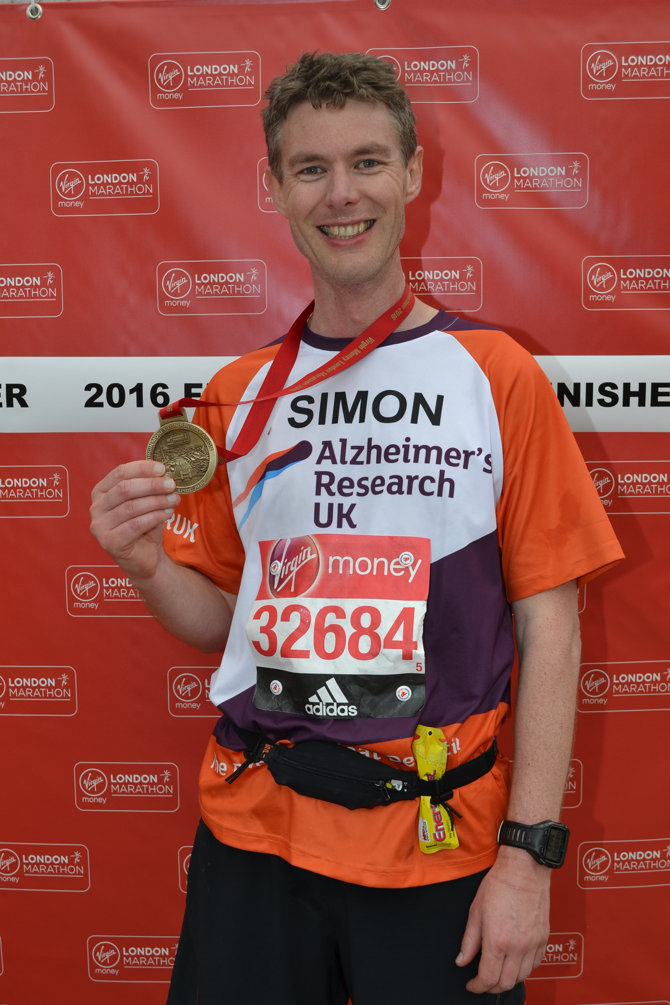 simon with marathon medal